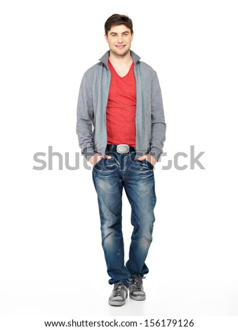 Full portrait of smiling happy handsome man in grey jacket, blue jeans. Beautiful guy standing  isolated on white background.