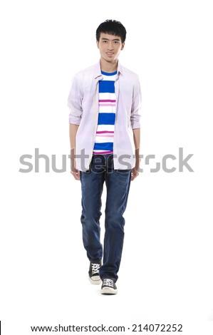 Full portrait of smiling walking man - stock photo