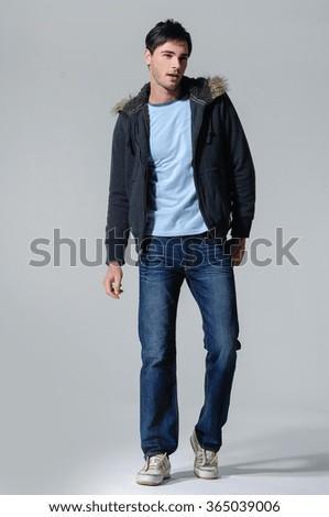 Full portrait of smiling walking man casuals posing - stock photo