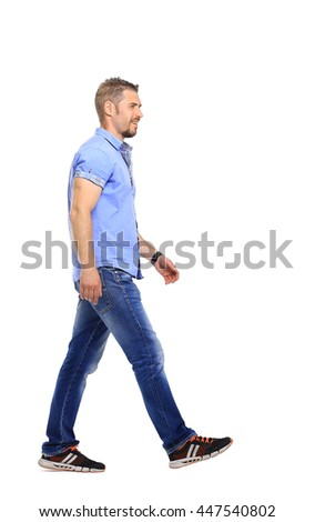 Full portrait of smiling walking man in blue shirt casuals isolated on white background.