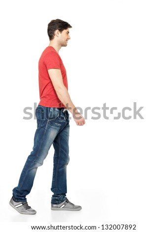 Full portrait of smiling  walking man in red t-shirt casuals  isolated on white background. - stock photo