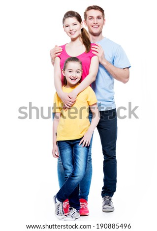 Full portrait of the happy young family with daughter in multicolor shirts - isolated on white background. - stock photo
