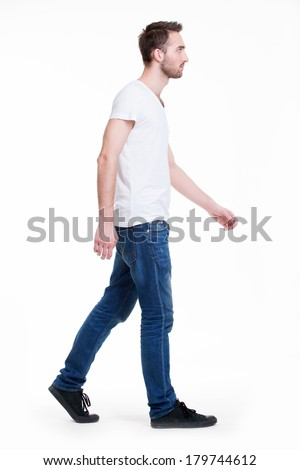 Full portrait of walking man in white t-shirt casuals - isolated on white. - stock photo