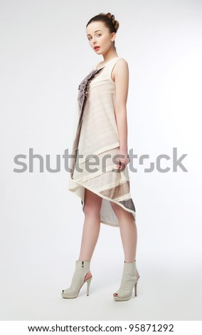 Full portrait of young beautiful fashionable woman with modern coiffure - series of photos - stock photo