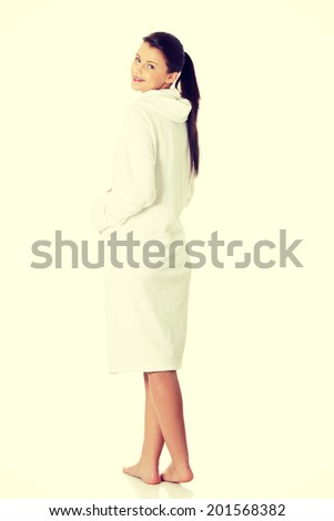 Full portrait of young beautiful woman wearing bathrobe - stock photo
