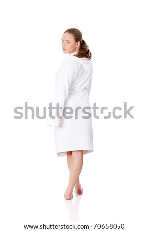Full portrait of young beautiful woman wearing bathrobe, isolated on white - stock photo