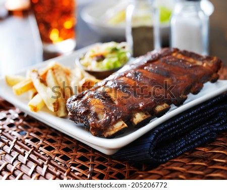 full rack of baby back ribs in barbecue sauce - stock photo