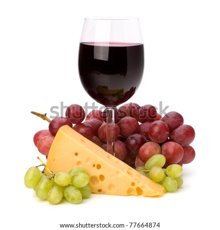 Full red wine glass goblet and grapes isolated on white background