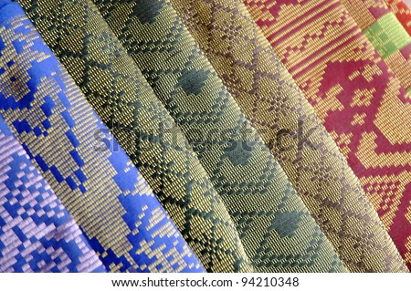 Full row of various hand-woven Songket textile - stock photo