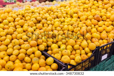 Full shells with tangerines in supermarket. World consumption problem. - stock photo