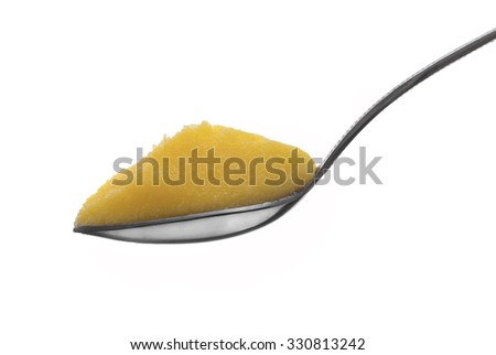 Full Spoon of Pure Indian Ghee Isolated on White Background - stock photo