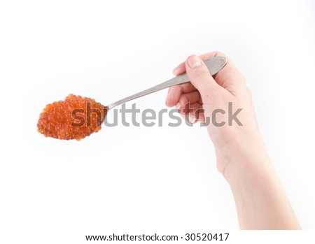 Full spoon of red caviar in hand