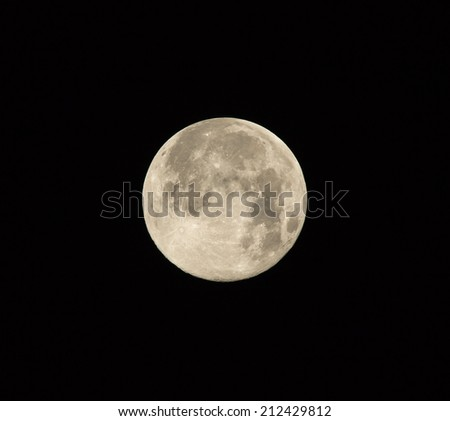 Full Supermoon on August 10th, 2014 photographed in Brighton, Sussex. - stock photo