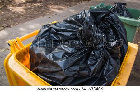 Full trash bin - stock photo