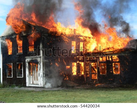 full view of house fire - stock photo