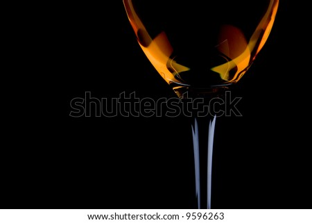 full wine glass on the black background - stock photo