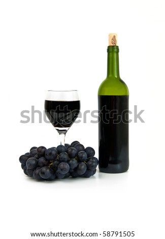 Full wineglass, bottle and dark grape on white background