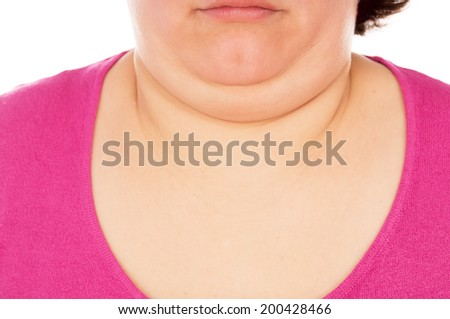 Full woman shows the second chin, isolated on white background - stock photo