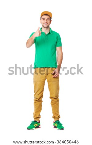 Fullbody portrait of young man posing in studio isolated on white. - stock photo