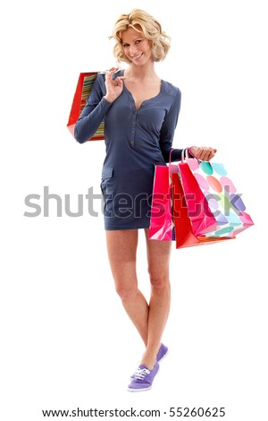 Fullbody shopping woman holding bags - isolated over a white background