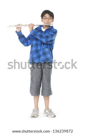 Fullbody young boy plays flute - white background