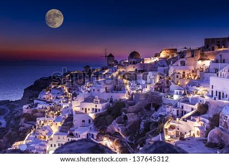 fullmoon above Santorini island in Greece - stock photo