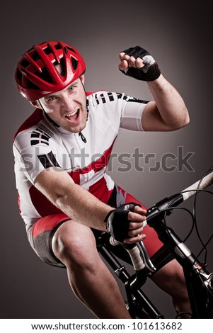 fully equipped cyclist riding a bicycle - stock photo