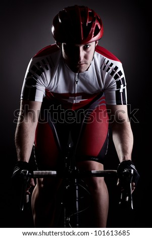 fully equipped cyclist riding a bicycle