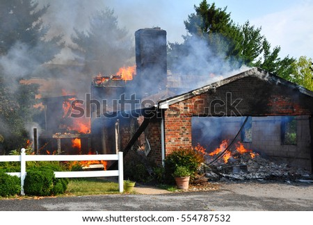 fully involved residential fire, view of garage
