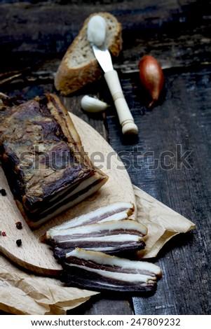 Fumed wild boar meat - stock photo