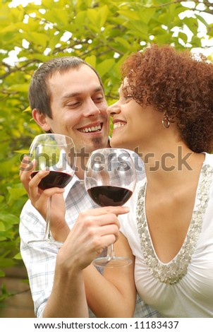 Fun and loving couple at a wine tasting - stock photo