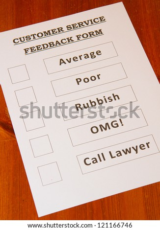 Fun Customer Service Feedback Form loaded with bad options including average, poor, rubbish, OMG and `Call lawyers` - stock photo