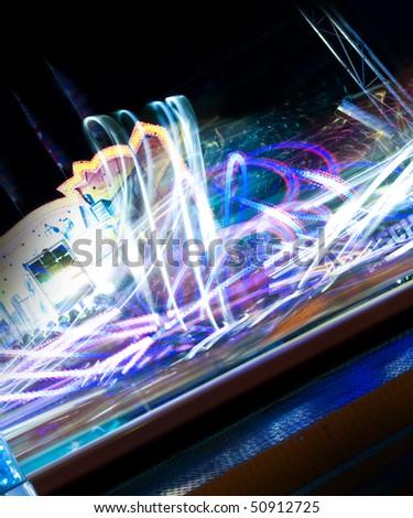 Fun fair spinning lights from carousel - stock photo