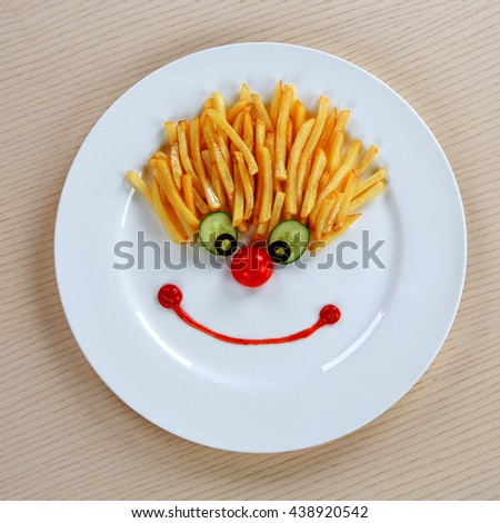 Fun food for kids beautifully laid out on a beige table - stock photo