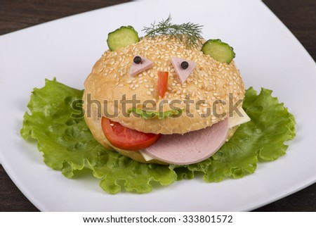 Fun food for kids - hamburger looks like a funny muzzle - stock photo