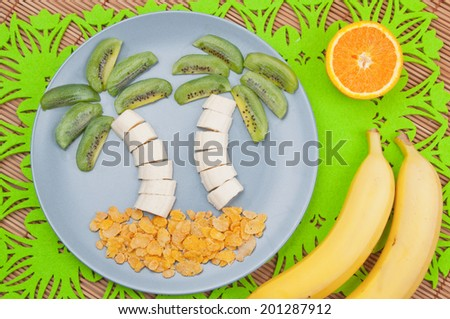 Fun food. Palm trees made from fruits - stock photo