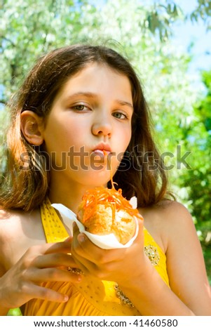 Fun girl eat hot-dog on nature background