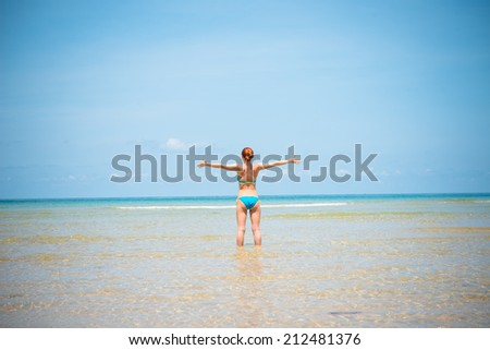 Fun girl wearing bikini having good time on a beach