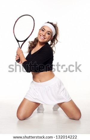Fun, happy young woman ready to play tennis in a white skirt with a racket in hand