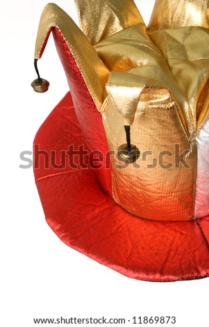 fun hat worn by a jester isolated over white - stock photo