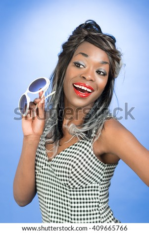 Fun image pin up style with sunglasses against a bright cheerful blue background
