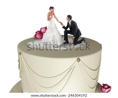 Fun marriage proposal on the big cake - stock photo
