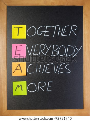 Fun, motivational team acronym on a classroom blackboard - stock photo