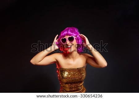 fun purple wig girl dancing party with heart shape glasses on black background