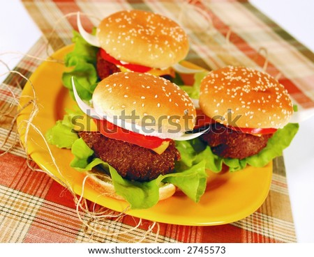 Fun texan hamburger with onion horns like a bull - stock photo
