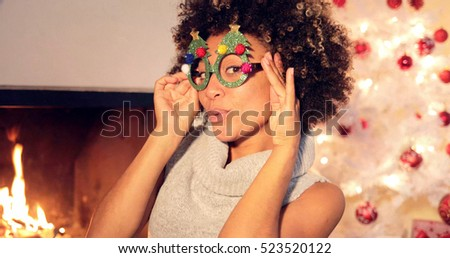 Fun vivacious young woman celebrating Christmas