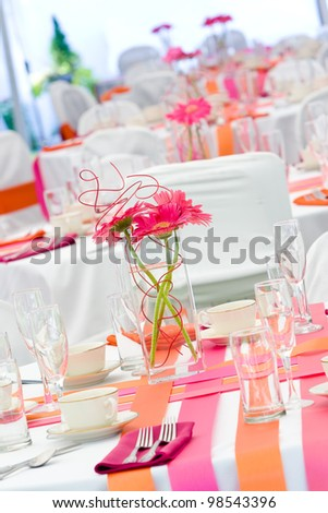 Fun wedding tables set for dining during a banquet or wedding event - stock photo