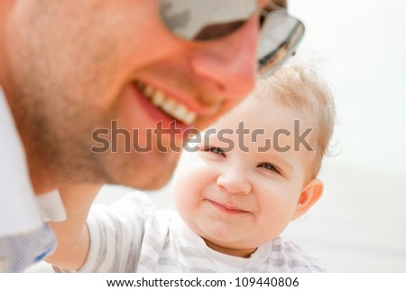 Fun with child on the beach - stock photo
