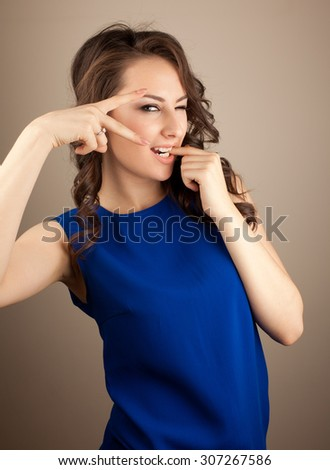 Fun woman showing sign ok and wink at - stock photo