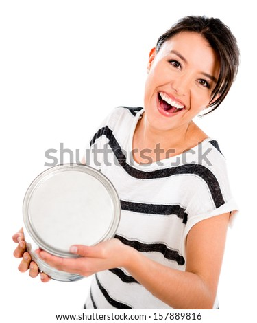 Woman throwing painting from a can isolated over white background